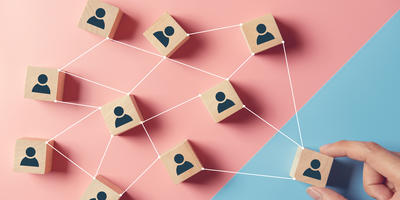 building-strong-team-wooden-blocks-with-people-icon-blue-pink-background-human-resources-management-concept