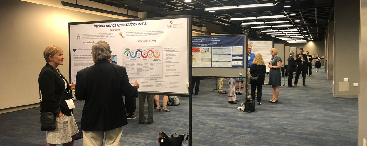 Attendees of the Fall 2019 Program Meeting view posters from around the CTSA consortium