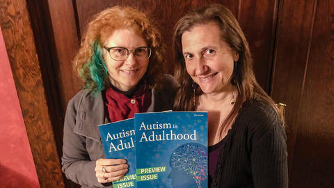 Dora Raymaker (left) and Christina Nicolaidis hold copies of the new journal Autism in Adulthood.