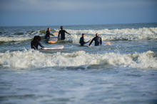 Veterans learning the art of surfing with help from Warrior Surf instructors and wellness coaches.