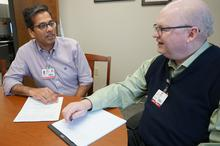 Atul Kothari, M.D., meets with TRI Associate Director John Arthur, M.D., Ph.D., to vet his study idea for possible multisite collaboration in the Trial Innovation Network.