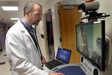 David McSwain shows how a telehealth cart works