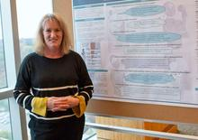 Carol Thrush, Ed.D., presents a research poster at the Women in Research Poster Showcase in November 2019 at UAMS.