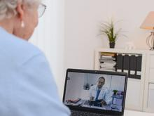 Patient talking with doctor via telemedicine