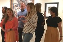 MUSC health sciences students assume poses of persons depicted in artworks at the Gibbes Museum of Art.